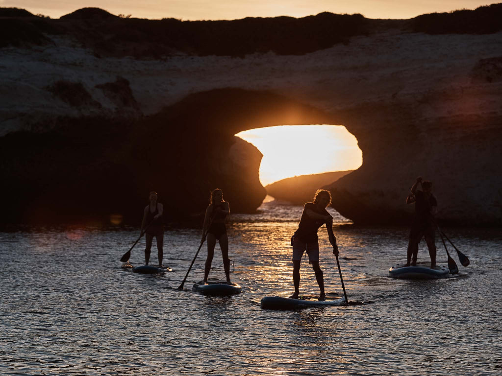 Paddlers at sunset on all around boards
