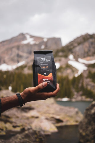 Holding A Bag of Coffee in Rocky Mountain National Park