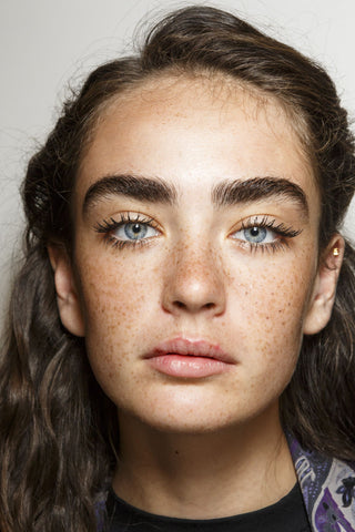Woman with natural freckles