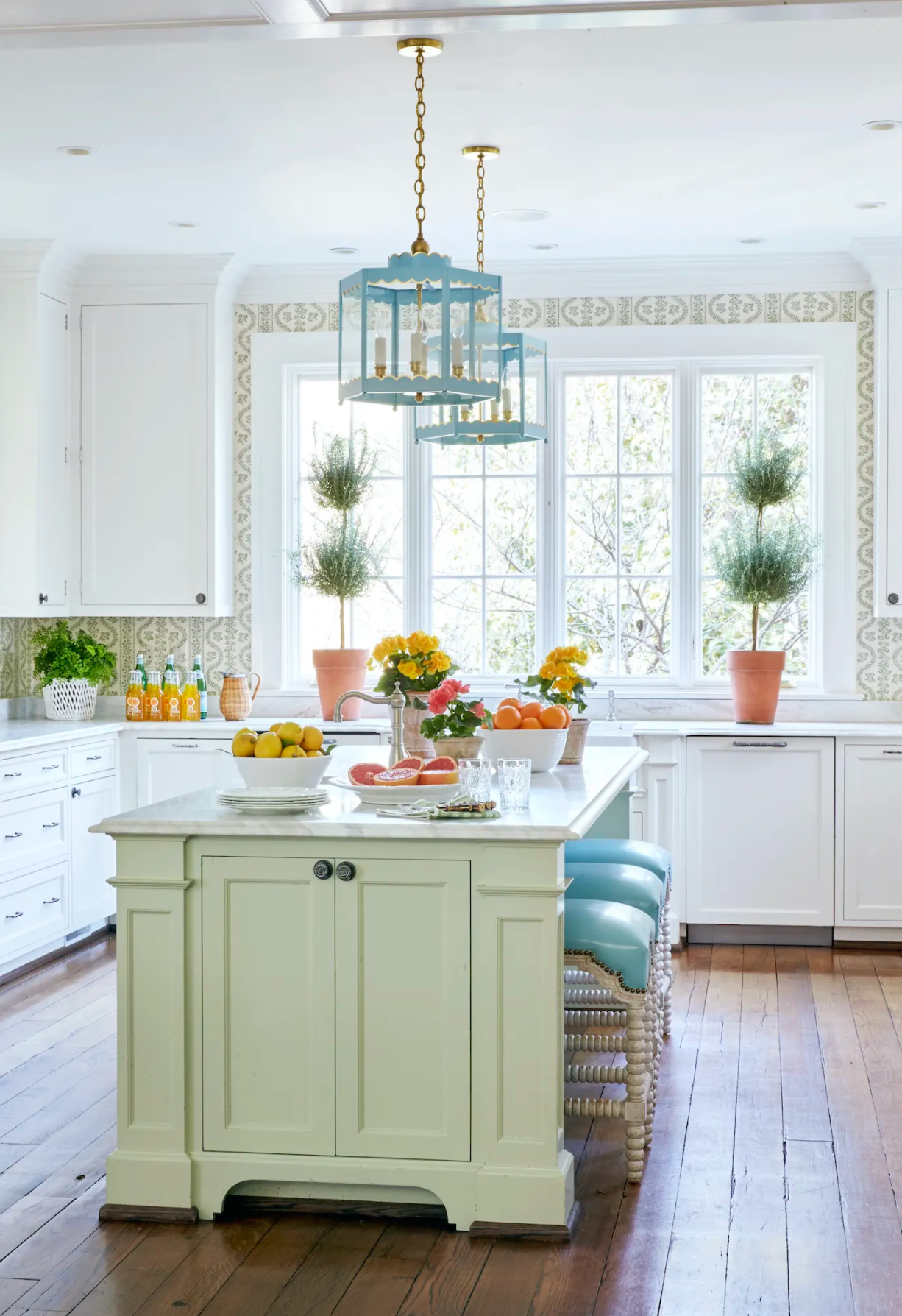 A Pair of Scalloped Lanterns in a Custom Color Over a Kitchen Island / Design by Sarah Bartholomew Interior Design / Photo Courtesy of Traditional Home Magazine