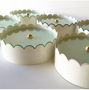A Group of Ivory Scalloped Flush Mounts w/ Various Trim Colors