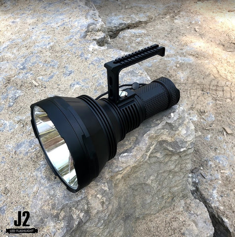 Acebeam K75 powerful search light with a side handle in Toronto, Ontario, Canada.