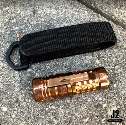 Acebeam TK16 Everyday Carry Flashlight in copper with holster.