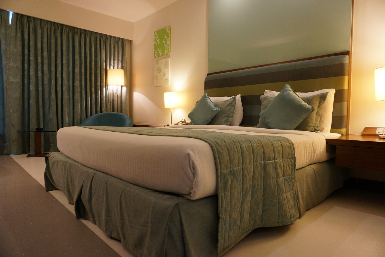 bed with green and tan bedding