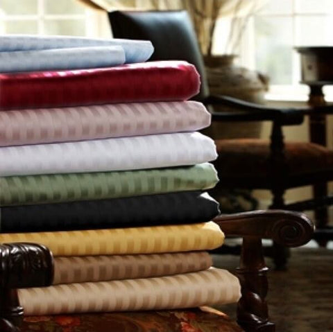 A stack of striped Egyptian cotton sheets from Royal Egyptian Bedding.