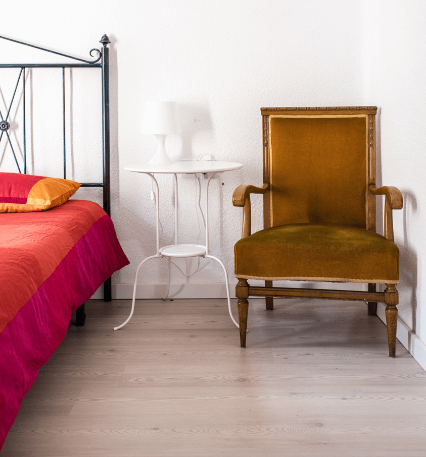 Classy Bedroom with Elegant Red Bedding and Antique Chair