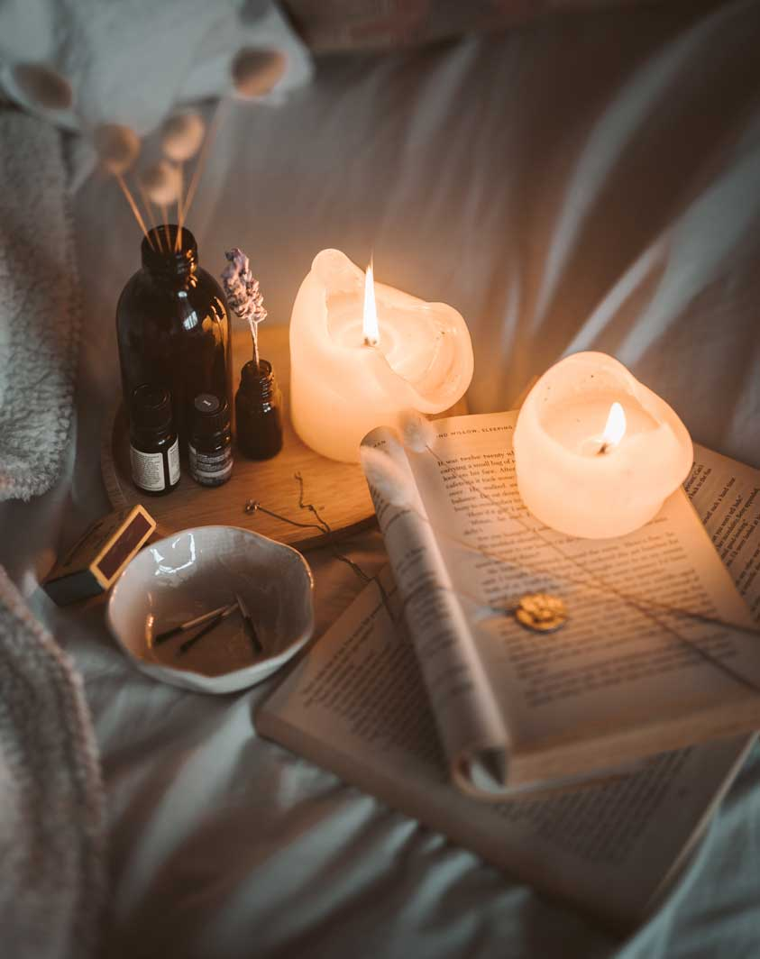 Lit candles and an open book