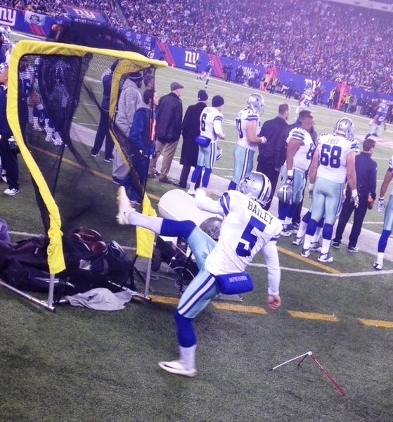 Dallas Cowboys on New York Giants Sideline Kicking Net