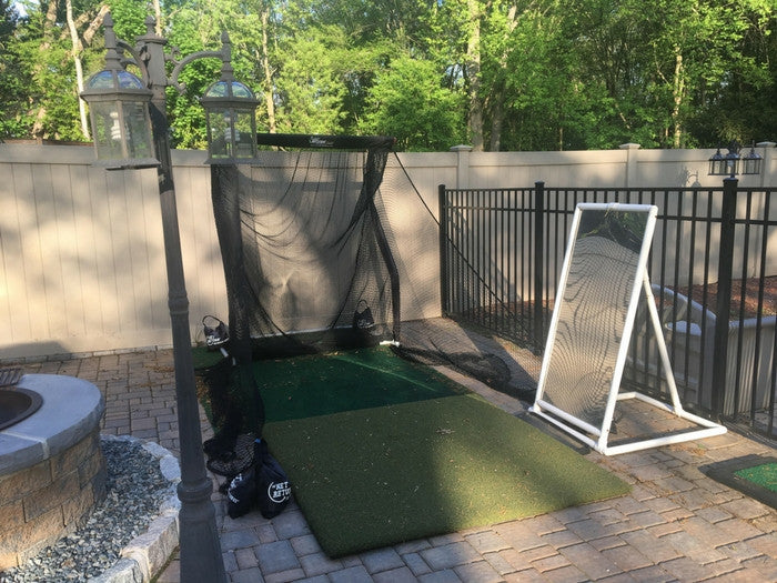Saul Ortiz Mini Golf Net in Backyard