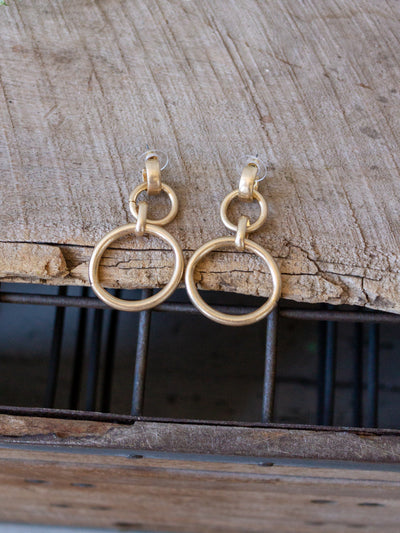 A gold linked earring.