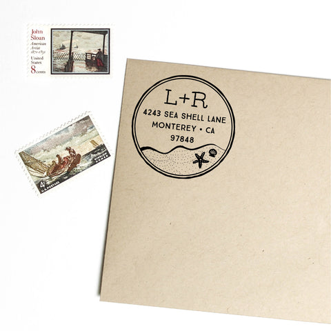 Circle return address stamp with ocean, sand, star fish, shell, and initials, self inking