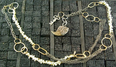 Melissa Joy Manning 14 K Yellow Gold and Pearl Necklace , with Key and Petrified Charm