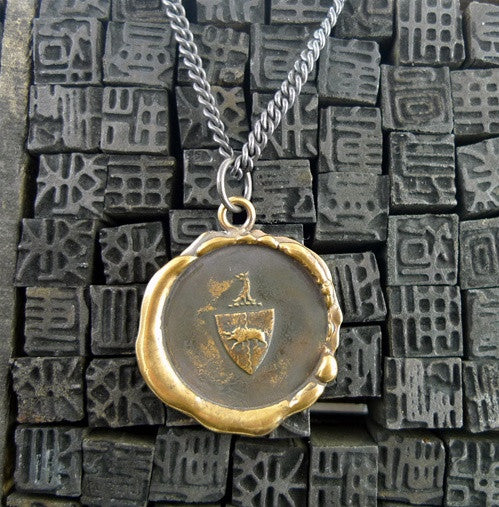 Pyrrha Bronze Crest Pendant Necklace