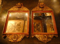 Pair of Italian Baroque Style Cherub Mirrors in Terra Cotta Tones and Parcel Gilt