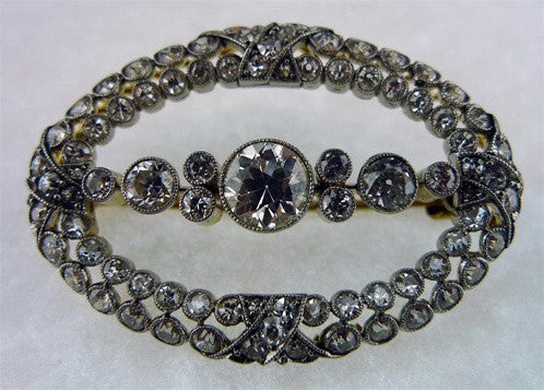 Antique Oval Shaped Diamond Brooch in Platinum and 18K Yellow Gold