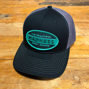 The Beautiful Madness Trucker Hat – Black