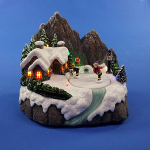Christmas 20cm Mountain Scene with Moving Skaters Battery Operated