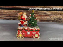 Load and play video in Gallery viewer, Musical Santa With Tree on Cart Christmas Music Box