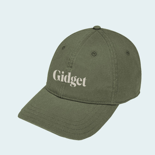 Women's wilderness green  colored dad-hat with print of g-fin logo