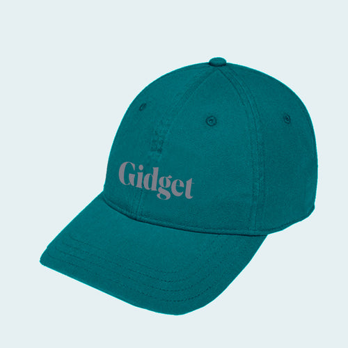 Women's rough sea green colored dad-hat with print of g-fin logo