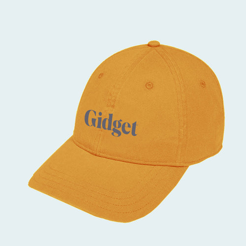 Women's golden hour colored dad-hat with print of g-fin logo