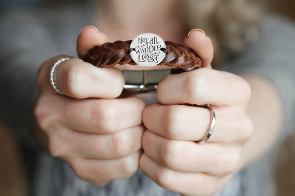 """Not All Who Wander Are Lost"" Engraved Silver Coin Sewn on a Leather Bracelet"