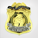 20th Anniversary 9/11 badge with kneeling fire fighter