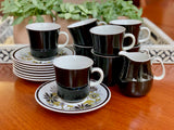 Mikasa (Japan) 'Leilani' flat cup and saucers, set of eight - plus creamer / milk jug