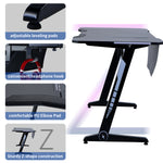 Home Office Gaming Desk Pro- Z Shaped PC Computer Table for Gamer Pro, Gaming Desks Workstation with RGB LED Lights,Headphone Hook and adjustable Pads,Black