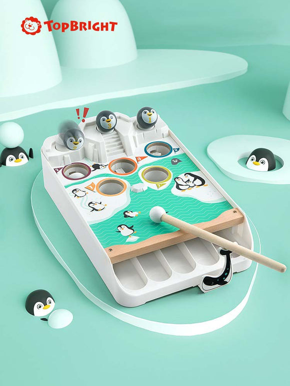 Top Bright - Penguin playing snowball table game