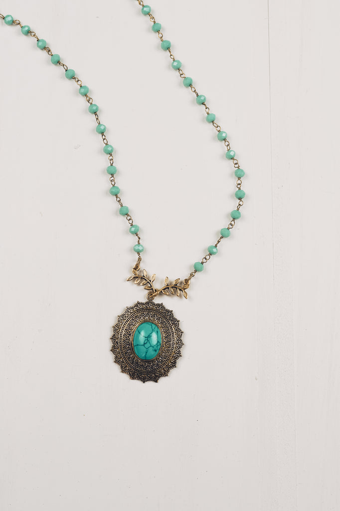 Brass Tibetan Pendant on Turquoise Crystal Beads