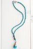 Blue Howlite Tibetan Bead Pendant and Faceted Turquoise Bead Necklace
