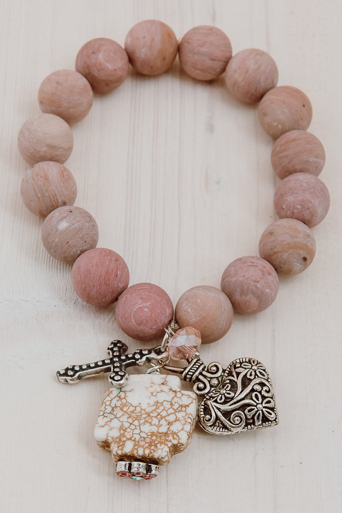 Rhodochrosite Matte Charm Bracelet with Howlite Cross, Filigree Heart, Cross and Crystals