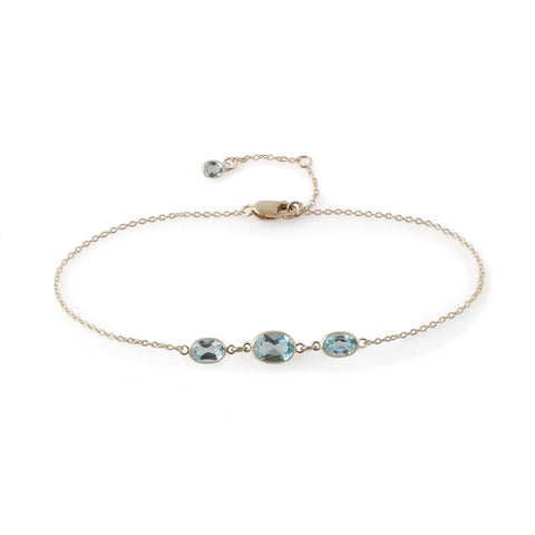 THREE STONE BEZEL SET BLUE TOPAZ BRACELET