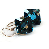 white gold radiant cut london blue topaz earrings