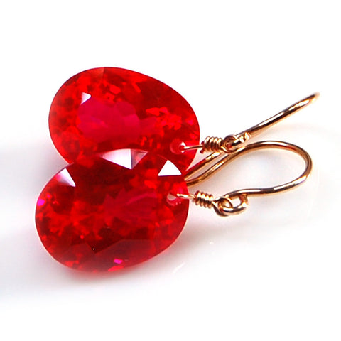 RED TOPAZ OVAL CUT SOLITAIRE EARRINGS