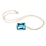 white gold emerald cut blue topaz necklace
