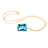 yellow gold emerald cut blue topaz necklace