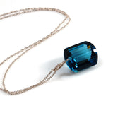 white gold emerald cut London blue topaz necklace