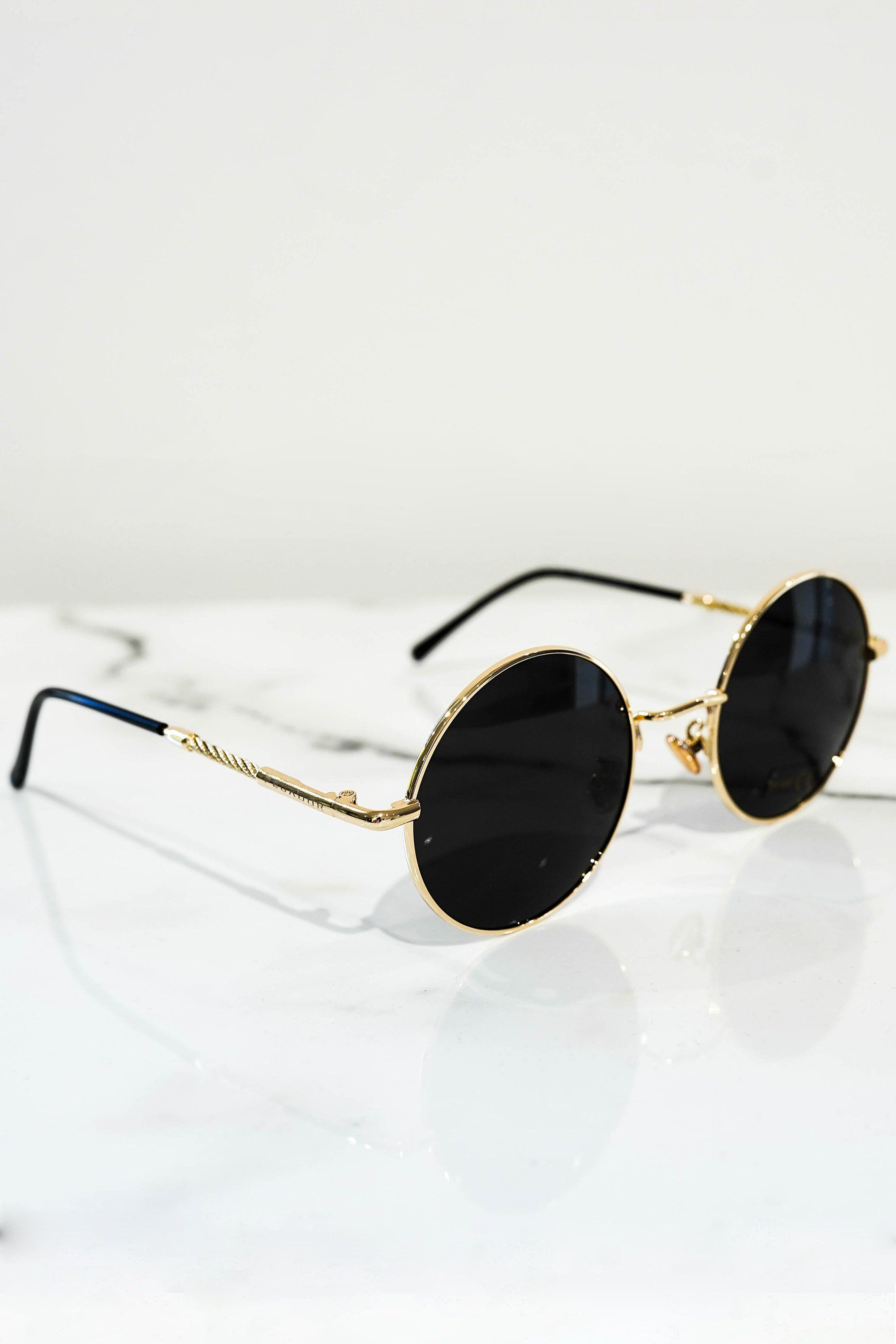round sunglasses gold with dark lens