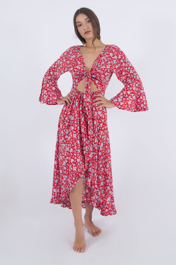 Our Paola long summer dress with bell sleeves in red floral pattern.