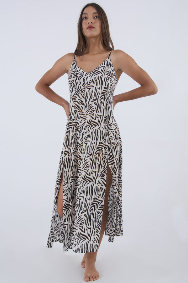 Our Madonna animal print dress, maxi with spaghetti straps and side splits.