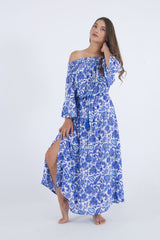 Our Maui cold shoulder dress, maxi with side split in blue floral.