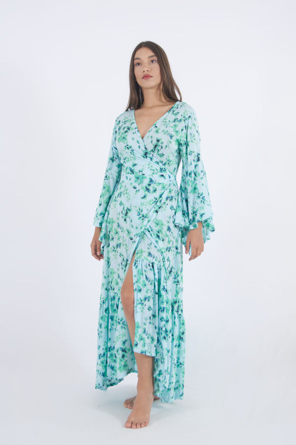 Our Wrap trumpet Long dress in green floral pattern, ideal for pool parties and evening outings.