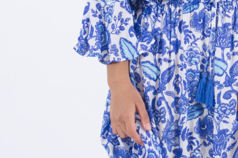 Detail of flare sleeve from our Maxi summer dress in blue floral print.