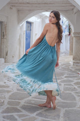 Long, halter neck dress in blue color. A summer outfit with open back.