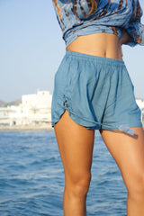 Blue shorts, blue rayon, with small side lace up and elastic waistband.