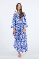Model wearing our Maui off shoulder dress in blue floral print.