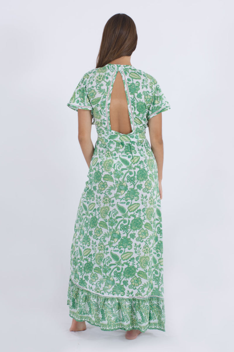 Back side of our Palma summer dress, a day to night outfit in green floral pattern.
