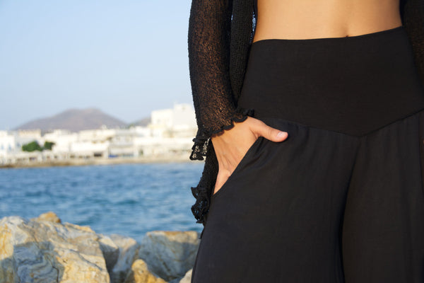 Detail of pull-on pants with wide elastic waist in black rayn